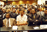 Mozambique Election Photograph - MONAMO and FUMO members listening to election results by Ferhat Momade