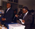 Mozambique Election Photograph - Brazao Mazula voting by Mario Cossa