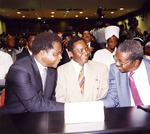 Mozambique Election Photograph - Afonso Dhlakama, Vicente Ululu, and Armando Guebuza in conversation after election results announcement by Ferhat Momade